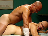 "gay porn Titan Ulizes Carpelli  || Ulizes Carpelli brings new meaning to the term ""bedside manner"" while attending to his patent, Joey Dino (Holler), who's laid up with a broken leg and a broken arm. Joey's also got his balls in traction with a ball stretcher connected to some massive weights hanging from a pulley off the side of the bed. Ulizes eagerly nurses Joey's amply thick cock while tugging on the ball chain. Talk about physical therapy! Using the adjustable hospital bed to their advantage, the two buff and bald bad-asses go at it with total abandon. Ulizes starts by straddling the bed-ridden stud and riding his perma-hard monster cock. Joey's two plaster casts dont interfere with his giving Carpelli's ass a must-see-to-believe pounding. Stubbly Mario Montana secretly watches on from the hallway, pulling on his giant, uncut pud the entire time."