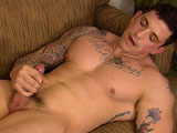 gay porn Sergeant Slate || Sergeant Slate enlisted as a US Marine because he wanted to be part of something bigger than himself. He served a full 8 years because he knew that as time went on, he'd get better positions and more responsibilities. He tells a story of fighting the bad guys in Afghanistan. One night, as his helicopter was going in to take out an enemy position, they started taking fire. Men had to fight in their boxer shorts in order to ward off the combatants. Hearing the other side laughing at them over the radio, the Marines decided to pull out the big guns. They ended up taking out the bad guys and everybody survived. After telling his story, Slate is ready to show us HIS big guns. Leaning back on the sofa, he massages his meat through his cammies. He takes off his shirt and reveals giant muscles covered by colorful ink. He's ready to whip out his military cock and starts stroking; his giant biceps flexing with each motion of his hands. He lays back to really enjoy himself, edging his cammies all the way down to his combat boots. His schlong grows as he caresses it. Standing, he bends over with his massive ass up in the air, still stroking. He reaches back and spreads his round ass cheeks to reveal a perfectly puckered pink hole. With his eyes tightly closed, he works his index finger into his sphincter, massaging his prostate from within. A little more rectal pleasure and he's ready to unload. His cheeks become more flushed as his pleasure juices start to swell to the surface. Several thick pellets seep out of his stiff soldier, dripping down his shaft and into his dark brown bush.