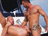 gay porn Adam Killian And Chris || It doesn't take long for muscle-hunk Adam Killian and blond sex-pot Chris Daniels' boat ride to heat up: while still on the dock, the two embrace for some hot kissing and groping. Adam breaks away to board the boat, Chris unties from the dock, and they're off. While on the open water, they slide out of their shorts, revealing their tight blue Speedos, and Chris starts work on Adam's thick meat with his hungry lips. Adam holds Chris' head as it bobs up and down -- he's more than comfortable lounging on the deck! It's soon Chris' turn, who peels off his Speedo, letting his big dick flop out so Adam can eat it up. They lick and lather each other's cocks before Chris sit on Adam's face, who happily eats out his hole: Chris' face scrunches up in ecstasy (and some fingers even slip in his ass, too)! When the fucking begins, Adam pushes Chris against the boat's deck, hoists his legs up in the area, and repeatedly fucks him deep and without mercy! Chris flips around in various positions -- sitting on Adam's lap, bending him over the bow -- letting him plow the blond stud hard until he bursts with cum!
