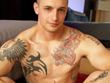 gay porn Ezra's Debut || Say hello to Active Duty's Ezra! This 21-year-old has a well-muscled body with colorful tattoos and a rear that'll bring a tear to your eye. He weighs 165 lbs and is a former high school wrestler that's visiting us from the North East. He gave a great first solo show that ended with an explosive orgasm and a hot shower.