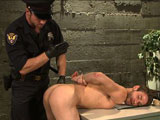 gay porn Connor Maguire And Dun || Deep inside Kink Prison, Officer Maguire brings in new inmate, Duncan Black after chasing him down on the street. Duncan's clothes are removed as Connor checks him for contraband. After inspecting the boy's hole, Officer Maguire takes his cock out and shoves it in Duncan's mouth before locking him up in his cell. As Duncan lays in his cell Officer Maguire breaks in and tears a hole in Duncan's pants, his ass ready for Connor's hard cock. Duncan tries to scream for help but Connor handgags him as he rails him from behind. The prisoner's arms are bound to a giant block of wood as Connor pulls on Duncan's nuts while giving him a taste of the flogger. Duncan's screams get Connor horny again so he lifts the boy's legs in the air for one more fuck. Connor brings his prisoner to the ground, covering his face in cum before milking a load out of Duncan's beautiful cock.