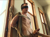 gay porn Tripp Townsend || Here for his very first shoot ever is Tripp Townsend, this hung stud is a little nervous so we start him off in easy bondage. Tripp's blindfolded and bound next to the windows as John Jammen helps Van get the boy's cock hard. They play with Tripp's nipples, sucking on them hard as Tripp's cock starts to grow. He's edged with vibrators on his cockhead before Van shoves John's head down on Tripp's cock just as he's about to blow. Back in the big room, Tripp has a ball gag shoved in his mouth as he's suspended in the air with his hung cock dangling. John whips out his cock and shoves it in the boy's mouth as Van ties in a dildo on a stick to fuck Tripp's tight hole. The bound stud is brought down onto the bed with tit suckers on his nipples while having John suck his cock. Tripp's brought to his knees, sucking John's cock as a vibrator is shoved up his ass. After much tickling, Tripp finally cums all over himself before he's finished off with the hitachi on his sensitive cockhead for some post-orgasmic torment.