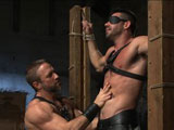 gay porn Billy Santoro And Dirk || Muscled hunk Billy Santoro stands bound in rope with a blindfold around his eyes as his leather master, Dirk Caber approaches. Dirk begins pinching and biting Billy's nipples before warming him up with punches to the chest. Billy embraces the pain as his leather master breaks out the flogger and beats the stud front to back. Their cocks are rock hard as Dirk fucks Billy from behind, handgagging his mouth to muffle the bound stud's screams as he drives his cock deeper and deeper. On Dirk's bed, Billy is bound with a gag in his mouth as his dom whips him with the crop. After taking Dirk's cock up his ass once more, Billy has wax poured all over his torso and rewarded with Dirk's load all over his face.