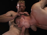gay porn Adam Herst And Jed Ath || Adam Herst has another captive in his lair and this time it's the muscle bound stud, Jed Athens. Blindfolded and fully bound, Jed is stripped down. Adam teases the man's cock through his boxers and clamps his teeth down on his hard on. He makes the new slave suck his cock and delivers a hard flogging with Jed tied to the ceiling. Anxious to get at the hot stud's hole, Adam fucks him where he stands before administering an electro challenge. Jed's freshly fucked ass takes the electric butt plug and makes him squirm in agony with Adam's cock in his mouth. A final fucking leaves Jed covered in both the men's loads and left alone in the bondage for Adam to use him again at his will.