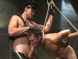 gay porn Connor Maguire And Abe || Officer Abel Archer is doing his rounds, when he notices another officer, Officer Connor Maguire, having his way with one of the inmates. When Officer Archer threatens to expose the dirty cop, Officer Maguire quickly cuffs him and throws him in the cells as well. Abel's mouth is pried open to swallow Officer Maguire's hard cock before he's turned around for a deep ass fucking. Connor then beats his fellow officer down with the flogger, tormenting the stud's meaty pecs before he's suspended on the staircase. Abel struggles in his bondage as the electric zapper torments his hole until Officer Maguire shoves his cock up the stud's ass once more. After a deep pounding, Connor finishes off Officer Archer with a face full of cum.