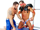 gay porn Nate Karlton And Spenc || Bound muscle jock Nate Karlton is tied to the metal truss in his football gear. Muscle jock Spencer Reed enters and blindfolds Nate and then starts pounding on his rock-hard abs with a football. Spencer works Nate up into a frenzy and strokes out a healthy load from deep down the helpless jocks nut sack!