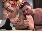 gay porn Adam Foot Worshiped By || Ricky Larkin is up to his foot worshiping antics again and this time he gets to adore the feet of sexy business hunk Adam. We all know how good Ricky can worship feet and he certainly doesn't disappoint Adam in this video. Ricky always puts his best foot forward when it comes to worshiping a foot stud like Adam. From sniffing his black dress socks to sucking on Adam's toes - he does it all!