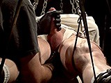 gay porn 05162015s2 || In a Long Leather, Chain, and Straight Jacket Suspension the Prisoner Lies Back With His Cock Standing At Full Attention.  He Squirms Against His Bindings and Awaits Whatever Evil Sir Has Planned for Him.  After a Long Period of Anticipating Sir Begins to Finger the Prisoner's Ass Making the Prisoner Squirm More Violently and Moan With Each Stimulation.
