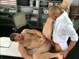 CJ Madison mistakenly thinks his boss Paul Wagner has left for lunch so he goes online for his afternoon porn fix. Mr. Wagner comes out of his office he finds C.J. stroking his huge cock and decides to get down on his knees and suck. Wagner pulls out his own cock and stands up so Madison can suck him off. Next the ass-hungry Madison flips his boss over and eats his hole, getting it lose and wet for his huge cock. Madison towers over Wagner as he shoves his huge tool in his ass. Madison drills Wagner long and hard until they both blow their loads on the desk!