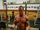 Griffin curls some heavy weights then shows off his biceps. See more videos like this at CamWithHim.
