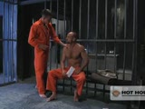 Prisoner Jackson Lawless makes the rounds handing out mail when he spies new inmate Chad Brock. Brock complains that he's horny as hell and within minutes stuffs his fat cock in Lawless' mouth. But Lawless, the ultimate greedy fist-pig, isn't satisfied. He orders Brock to shove his big cock and meaty paws up his ass. Finally, with the help of a contraband dildo, both men get their nut.