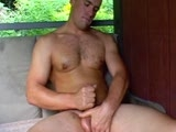 "If you want to watch a REAL MAN enjoying his rigid cock and heavy nut sack in a long, slow, sensual jerk off session you have cum to the right place! Hank loves to play with his balls while he jerks off! He moans & shoots volumes of cum having held off for 4 days before this return photo shoot. Handsome Hank is one of those very special straight men who doesn't mind being admired by a man and his camera. He is not afraid to look directly at us as his enjoys his fine body and beautiful cock! There is lots of eye contact in this footage and sexy Hank has the most piercing BLUE blue eyes. What a Stud! Hank works for a successful landscaping company in Honolulu. He is paid very well for climbing & pruning trees, so he does NOT need the money from these photo shoots. Hank does all this for us for 'fun' & extra cash and clearly enjoys it! He is a flexible well built man and is comfortable showing off his hole while on his back like Mario & Kawika! He is a great Naked Maid too: washing his lube covered hands before he unloads the dishwasher. Watching his great white muscle butt move around your kitchen is a treat! At one moment he is caught struggling to unload some pots & pans and I am able capture his GREAT WHITE CRACK on film. ""Something to take off is always nice,"" Hank states when I as him if he would like a Naked Maid for himself! There is lots of footage of ""Ole Blue Eyes"" two fisting his hard dick and fondling his nuts! Listening to him speak in dreamy! Hank is a fine Island Stud with a supper fine blue collar but"