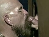 Mature beard man sucking cock in a glory hole.