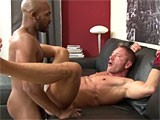 A horny interracial couple having anal sex.