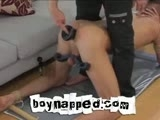 Strapped down, legs spread and balls locked in, Seth Roberts is forced to have his hole abused with dildos bigger, then a mans arm in this video! Watch and take pity on this cute American stud as he moans and cries out from the pressure as his ass hole is widened and stretched. To reward Seth, Sebastian takes the whimpering boy in his arms masturbating over Seth's shoulder sending mature cum running down the humiliated boys toned chest and abs.