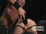 Jackson Lawless finds Patrick Rouge caged, pleasuring himself with a lengthy butt-toy. He circles his prey then spreads his butt cheeks on the iron bars, allowing Rouge to lick his hole. Lawless puts on a show by riding a huge dildo until Rouge demands to be let out of the cage so he can take over. The young muscular stud plows Lawless' ass with the enormous weapon then pulls on the rubber gloves and fists him hard. Lawless rides Rouge's fist while they both jack off and shoot hot loads.