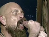 A horny mature bear male sucking a cock in glory hole.