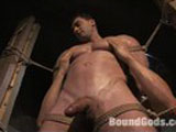 Huge bodybuilder Nick Armani has never been tied up nor been on camera with another guy. It was quite a challenge to make him feel at ease. I couldn't believe it when he agreed to get reamed by a dildo attached to the powerful Dragon fucking machine. The scene begins with Nick pumping his huge biceps, which entices me to give him a nude massage. But he falls asleep, and ends up getting tied up, manhandled, and fondled. Eventually, he submits his muscled ass to the medieval thrusts of the Dragon and blows his wad in ecstasy.