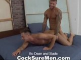 gay porn Bo Dean And Slade || Tattooed tough-guy Bo Dean and the soft-spoken, refined Frenchman Slade have a passionate afternoon together as they strip each other down and explore each other's bodies. Bo throws Slade onto the bed and jumps on him for some 69 action, the two men sucking on big, thick dicks, then Slade buries his face in Bo's furry asshole. Bo flips Slade over and slides in gently at first, building the energy until he's slamming himself hard into Slade's hole, kissing and touching him and keeping him in ecstasy. Slade sits on Bo's dick and before long he's blowing a big load all over Bo's chest. Bo flips Slade onto his back and blows his load right into Slade's face. The two sweaty men collapse into each other's arms, kissing and touching together.