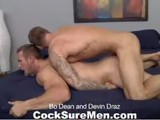 Bo Dean, one of our most popular models, returns for a suck-and-fuck encore with Devin Draz, another equally hot stud who gives as good as he gets. Man-to-man sex like this rarely gets any hotter. Bo gets the action started by getting down on his knees to service Devin's long piece of meat. By the way he swallows all that cock, it's obvious Bo's been paying attention all those times his big dick got slurped. Devin returns the favor--and then some--by exploring every part of Bo's awesome body with his tongue and fingers. He literally has Bo squirming with his oral technique (no sign of a gag reflex here!). Our big-dicked duo kicks the hotness up another notch as Devin gets on his stomach and puts that muscle butt in perfect position for Bo to slide all 9 inches into his hole. This is when the Bo we know so well hits his stride for a couple rides that lead to both guys spilling their loads.