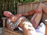 This week on Dirty Tony, cums a video from Tony's secret vault. The hunky Carson shows off his massive 9.5 monster cock in his own home! This studly man has a ripped torso, sculpted arms, and beautifully designed tattoos, which only enhance his muscular body. Carson works at a gay bar, despite being straight, however, he says the thought of hooking up with a guy has crossed his mind once or twice, but is still looking for the right guy to try it with...if he ever does. He definitely has the makings for a rough, dominant top and hopefully he will make his debut one day. Carson sits on his chair in the living room, rubbing himself down, slowly making that gigantic dick grow into it's full size. He works it up and down, stroking his long, hard shaft making it more eager to bust his awaiting load. Carson finally pushes himself over the edge blowing out a great stream of hot, white jizz over gigantic manrod.