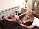 Businessman Guy has been lured back to a pervy man's apartment, plied with drink and then pinned down to be stripped naked and tied up to his captor's bed. An anal vibrator is set on high and shoved up his tight virgin asshole. His wrists are attached to nipple clamps and he's ordered to wank until he cums. While Guy painfully strokes his dick to erection, he's flogged and made to rim his captor Nick. To sexually torment the straight lad further pegs are attached to him and ripped off his hairy body. Download the new BDSM videos from StraightHell!