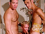Hairy studs Danny Hunter with his monster cock and Brandon Williams take turns fucking smooth blond Jared Scott!