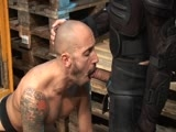 Tattooed Fetish Stud Jhony Hauls Bald-headed Hottie Valentin on a Forklift. Then He Rams His Rock-hard Rod so Deep In Valentin's Throat That the Drool Runs Out of His Mouth. After Working Valentin's Ass Over With His Dick, Jhony Plugs It With a Thick Dildo.