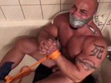 gay porn Gay Muscle Shower Boun || Big cocky muscle stud Billy Gunz finds himself attacked, bound and taken to the bathroom shower. With both his hands and feet tied up, Billy is fondled, stripped and by the muscle attacker while the water cascading down on his muscular body.