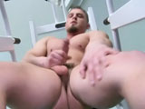 Brock Traynor started out in street fighting but found working out his muscular body was as much fun as working his hot cock.
