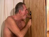 This hot mature daddy loves sucking cock and what better place to do that then behind the gloryhole - when this big cock was put through the hole he couldnt stick to just sucking it, he had to feel it in his ass too.