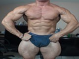 Alain Lamas Sexy Bodybuilder With Huge Quads Shows Them Off and Then Takes It All of to Show Off His Amazing Uncut Cock