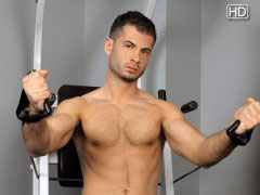 You are a voyeur, peeking in at the sexy jock stud Victor Cage as he works his body in the gym and then works his rock hard cock in the process.