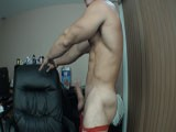 Alain Lamas Teases and Strips In His Sexy Red Jock Strap Getting His Cock Rock Hard and Then Busting a Juicy Nut