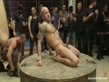 Drake Jaden is bound and blindfolded in a room full of wild partygoers at the Armory. Girth Brooks whips his giant cock out and everybody wants a piece of it. Drake is put in metal bondage and flogged. The crowd cheers as he screams for mercy. Drake is taken around and made to suck strangers' cocks. They give him a hard gang bang and blow load after load of cum all over his face. He endures a long and excruciating cum denial. Drake is allowed to cum at last. The crowd cheers because this boy can take it!
