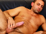 Hungarian hunk Renato Bellagio takes a long, hot shower and lets us watch. With a sparkling clean butt hole, Renato lies back on the sofa and plays with his foreskin, fucks his ass with a dildo, and jerks his fat uncut cock. All this stimulation delivers a healthy load of spunk!