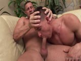 Moving Over to the Couch, Michael Troy Begins Sucking Off Jack Dragon, Who Takes Michael by the Head, Pumping Him Up and Down on His Rock Hard Cock!<br />