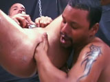 A massively thick,one foot and a half long dildo makes way for a greased up hand as they slide This next scene of Hot Desert Holes gets greasy and noisy. Martin's hole is greased up well as he hangs from the ceiling in a sling, his asshole getting expanded by Christopher's fist. The rummaging around makes him moan and groan. Led decides to make him groan louder by stuffing his big cock up Martin's hole as well, that's while Chris's fist is still in there of course! With Led now in front of Chris, his hole is also in the firing line and gets worked over while he still drills Martin. After withdrawing, Led helps Chris stuff his big black cock up Martin's lathered up hole. Chris takes turns at more savage pounding and handballing of Martin's puckering pink hole.