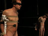Hayden Russo shows up with a 10 inch cock and he wants to dom on BG. He's new to BDSM so it's a good idea to tie him up and give him an intro to bondage and some corporal. Respect for the bondage sets in when he feels the numbness within minutes of getting tied up. Slave boy Matthew Singer comes in and gives head while Hayden receives a nice flogging. Both studs get tied up and the first one to break free will fuck the hell out of the other one in tight bondage.