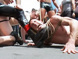 Josh West and Spencer Reed drag Jason Miller who is bound, completely naked and barefoot through Up Your Alley Aka Dore Alley Fair. The crowd cheers as Josh beats the hell out of him. Spencer makes the slaveboy crawl around and suck his foot in public. The crowd goes wild as Jason squirms and screams with an electric buttplug in his ass. He endures the single tail whip and the full body zipper. The doms find an open garage and fuck the boy hard. Other dudes jump in on the action. They all blow their loads on his face. The muscle slave is dragged through the streets one more time with a face full of cum.