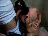 Brian Bonds is hooded and tied to a toilet in a public restroom. Horny men grope the dirty boy and piss all over him while he's sucking anonymous cocks. They beat up the bound stud. One dude shoves a baseball bat up his ass and the crowd goes wild. He receives loads after loads of piss and cum. Christian Wilde shoves his barefoot in the boy's nasty mouth. They all take turns fucking the piss pig. This is a piss galore afternoon.