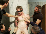 Big dicked stud Phenix Saint drags sexy Ethan Hunter to a grungy public restroom for a few hours of sucking cock. But Ethan gets more than he bargained for when the group of sex starved bathroom cruisers rip his clothes off, grope and manhandle him, and make him take turns sucking their cocks. Ethan endures some heavy flogging, a painful double zipper and is made to lick the men's boots clean. After sucking some huge cocks through the glory holes, Ethan is bound, gagged, and suspended inside one of the stalls where the horny men take turns fucking him. Completely spent, he ends up on the filthy bathroom floor where he takes load after load of hot cum.