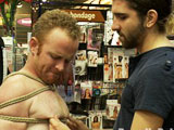 Tristan Jaxx takes Alex Summers in a local porn store for some fun. With the help of the public, Alex is bound and his shirt and pants are torn off. The horny boy is made to suck Tristan Jaxx's giant cock. The crowd moves in and they all have a piece of the boy. Alex endures the ass spanking, ass licking, flogging and fucked in the middle of the store. They spit on exhausted boy and drag him into the sex arcade. They drill his ass with the fucking machine through the glory hole. Everyone fucks him some more and cum all over the whore.