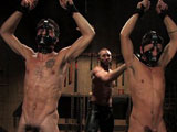 In the dungeon this week, Geoffrey Paine has two uncut subs, Dominic Pacifico and DJ. Mr Paine flogs them into submission. He plays with their cocks and slides his own cock into their spider gagged mouths. Dominic takes most of the corporal which includes the crop, the cane and the little nasty black clamps. To end the day, Mr Paine ties up Dominic and fucks him while DJ sucks his buddy dry.