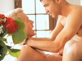 Hot stud romances lover with flowers.