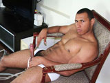 "gay porn Jose Manuel || Jose Manuel is a young horny guy referred to us by a friend.  At 20, this 6'0"" 190 lb. stud was beefy and hairy...just like we like 'em. Watch him slowly tease us by exposing his uncut cock from his briefs, then slowly stroke it so the blood would make it swell. Sitting there all naked with cock throbbing will surely cause you to blow...just hold back...there's more. He stands up on the table, showing off his massive frame, then does a bit of flexing with his dick hard. We move underneath him to be sure you can see all of his hard cock. This ex-football player then slowly moves to the bedroom, kicks back on the bed, stretches his large hairy legs, then jerks his cock and blows jizz everywhere. Think you've had enough? Go ahead! Blow your own load with Jose Manuel."