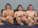 Three relative newbies are in bed together today; Spencer, Brandon and Zane. Despite all three of them looking rather nervous, all three boys said that they were looking forward to the shoot, even if it was just the prospect of earning more easy cash. Each of the boys couldn't help have an anxious grin when they were told that today's expectations were pretty high.Getting the party started, I had Spencer, Brandon and Zane take off their t-shirts, their jeans quickly following. Once they were sitting next to each other naked, they took their cocks in hand and started to jerk themselves off, their dicks steadily rising to the occasion. When all three dicks were rock hard, it was time to decide who was going to suck dick first. It wasn't quite so surprising when Zane, our bi-curious boy, put his hand up to go first. The three boys scrambled into position; Zane getting down onto his knees on the floor while Spencer and Brandon stood on either side of him. Kane took one good look at the two dicks pointing towards his face, pausing for only a second before allowing Brandon's dick to slide all the way into his mouth. What was surprising was Spencer pulling Brandon towards him and initiating a hot and heavy song with a more than willing Brandon. While the two boys were kissing overhead, Kane worked hard on the dick in his mouth even as he put in some fast and furious wrist action with Spencer's cock.