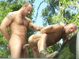 gay porn Titan Cj Madison Fucks Coby Mi || Decked out in his camouflage pants and vest, hunky CJ Madison cleans his gun while bald muscle bud Coby Mitchell watches as the two relax outside. What are you lookin at? asks CJ, suggestively holding his giant rifle. Thats when Coby leans in, planting his hand on CJs groin and his lips on CJs mouth. As soon as the two start kissing and rubbing each other, you can tell something special is in store. CJ whips out his big uncut meat, hovering over Coby as they continue to kiss and stare into each others eyes. CJ feeds his pre-cum to Coby, who kneels in front of the tall stud and sucks away. Cobys muscular biceps and legs flex as he gets to work, and CJ wraps his hand around the back of his pleasers head. CJ spits down on his own cock and starts to get more verbal as the scene continues, offering encouragement and instructions. The two cant keep their hands off each other, and Cobys cock throbs as he sucks CJ, soon licking his chest and pit. CJ licks his own pre-cum soaked fingers before feeding them to Coby, spit strands dripping from his mouth; after sucking Cobys stiff cock, the two jack off with a moaning CJ spraying a huge load all over his friend. Moving into the back of their truck, the duo continues to kiss. An amazing shot shows CJ grinding his throbbing cock (hands free!) against Cobys ass as the bottoms dick throbs all by itself. CJ finally slides his beast inside Cobys tight hole, and Coby takes control by sliding up and down: Ride it! Oh shityeah boy! Coby then turns around to get a kiss, wrapping his arm around CJ as CJ rubs Cobys leg. The two take turns in control of the fuck, showing off their muscular ass and legs as they thrust deep and hardwith CJs giant slab constantly disappearing. After turning around and stealing another kiss from CJ, Coby gets on his back and wraps his legs around the top. CJ leans down and the two kiss again as the fuck continues, with two more hot loads on the way: Cobys wad hits his muscular pecs, while CJ unleashes another gusher. Yet another kiss and a hot smile from CJ end this unforgettable scene.