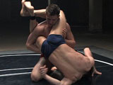 Big Cayden Banks is going head to head with Shane Erickson, who has martial arts skills. Cayden uses his weight advantage and dirty fighting skills against tall, lean, and cut Shane. After two rounds of this balls-slamming match, the two fighters are oiled down for the final Naked Round, in which the winner will sexually dominate the loser.