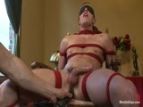 Alex Andrews is a wholesome straight guy that's only been tied up a few times with his girlfriend. We have him strip and tie him to the metal bars. He gets hard in his boxers so we cut them off and play with his uncut cock. He gets the vibrators on his cock and nipples as he squirms from pain and begs to cum. Arms up and legs spread we flog his ass til it's bright red and then fuck it. Suspended upside down we edge him and fuck his ass some more. In front of a mirror we tie him to a chair. His cock gets hard watching himself become restrained. We gag him and edge him once more. He nearly kicks himself out of the chair from how sensitive his cock has become throughout the day. After finally blowing his load we mercilessly keep fingering his ass and stroking his cock as he squirms to get out of the tight bondage.